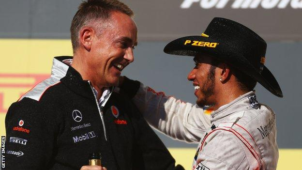 Martin Whitmarsh and Lewis Hamilton on the podium at the United States Grand Prix in 2012