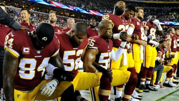 Washington Redskins players taking a knee as protest before an NFL game