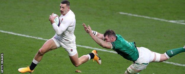 Jonny May runs away from an Irish tackle