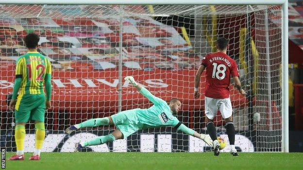 Sam Johnstone saving Bruno Fernandes' penalty