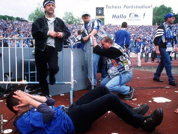 Schalke fans are disconsolate after realising Bayern have avoided defeat in Hamburg