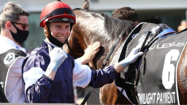 Jockey Jye McNeil after winning the Melbourne Cup on Twilight Payment