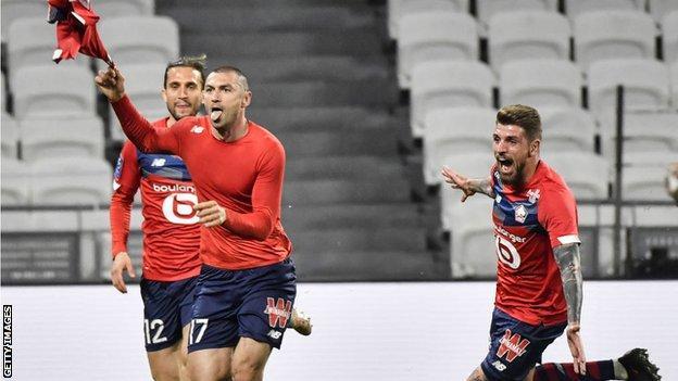 Burak Yilmaz and his Lille team-mates celebrate beating Lyon