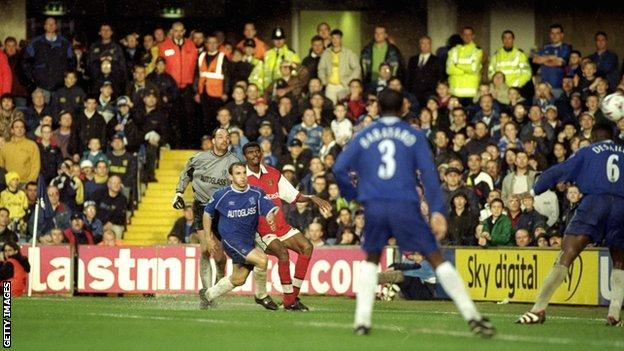 Nwankwo Kanu flights home his hat-trick goal from the byline