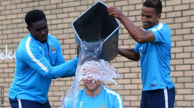 Micah Richards, Scott Sinclair and James Milner taking part in the ice bucket challenge in 2014