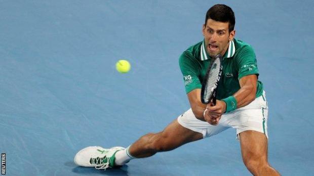 Novak Djokovic returns in his Australian Open quarter-final against Alexander Zverev