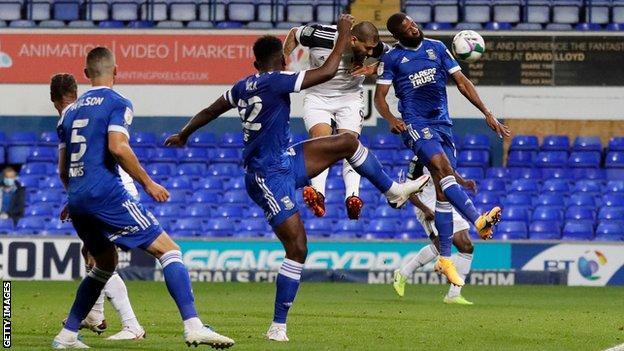 Aleksandar Mitrovic heads Fulham ahead against Ipswich
