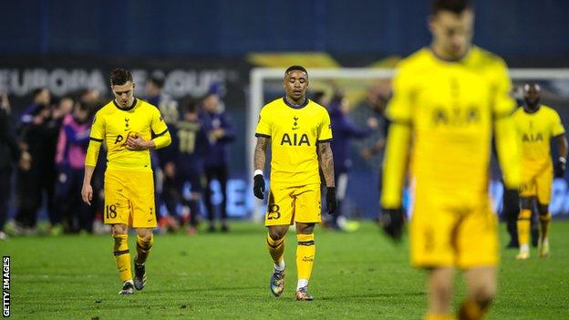 Tottenham players trudge off as Dinamo Zagreb players celebrate behind them