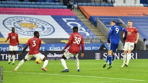 Jamie Vardy's shot is deflected in