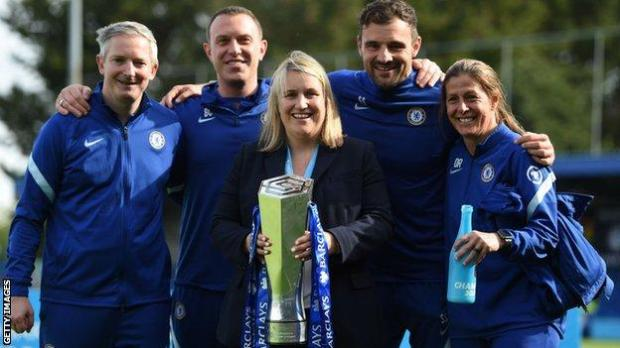 Chelsea staff with the WSL trophy