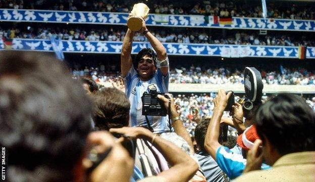 Diego Maradona holds the World Cup aloft in 1986