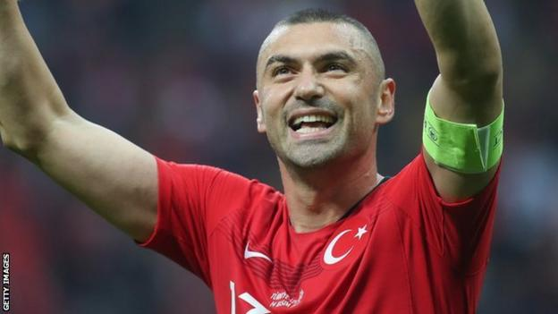 Turkey's Burak Yilmaz gestures to the crowd during a Euro 2020 qualifier against Iceland