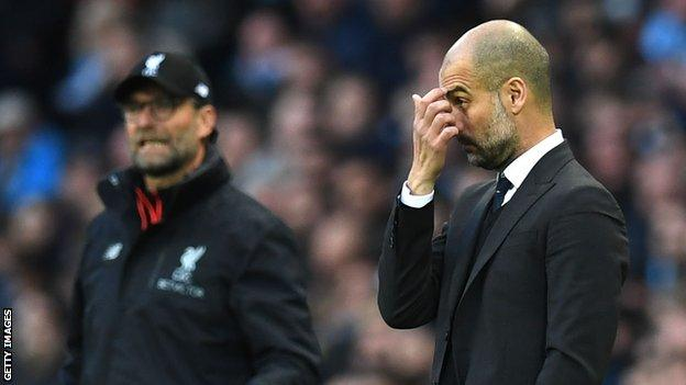 Jurgen Klopp and Pep Guardiola on the touchline during a Liverpool v Manchester City game