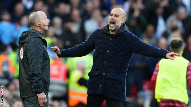 Man City boss Pep Guardiola (right) and fourth official Mike Dean (left)