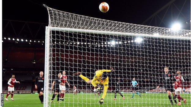Slavia Prague keeper Ondrej Kolar produces a save against Arsenal in the Europa League