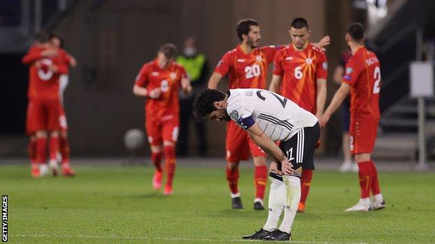 Ilkay Gundogan looks dejected after Germany are beaten by North Macedonia