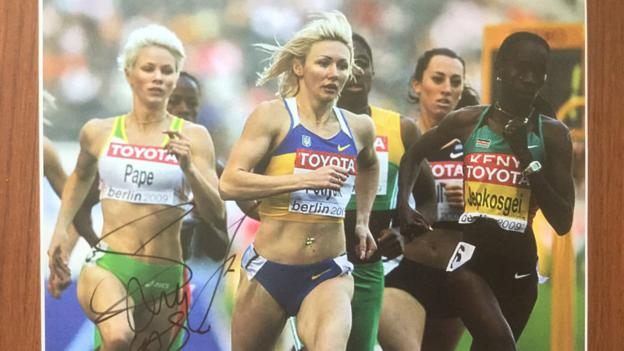 Autographed pictures showing Pape running alongside Caster Semenya in 2009