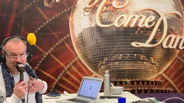 Simon Mann commentates in a Strictly Come Dancing-themed room at MediaCity in Salford