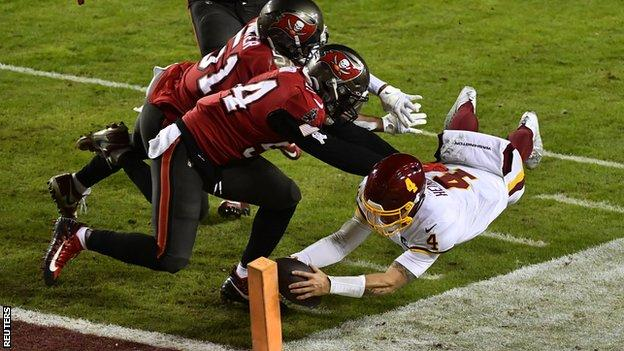 Washington Football Team quarterback Taylor Heinicke scores a touchdown against the Tampa Bay Buccaneers