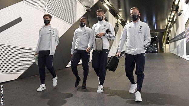 Juventus players arrive at the Allianz Stadium