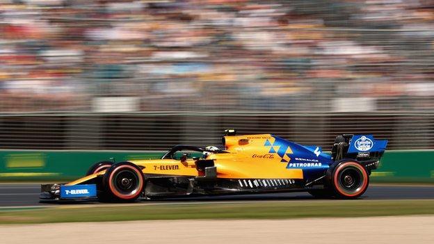 Lando Norris drives McLaren during qualifying