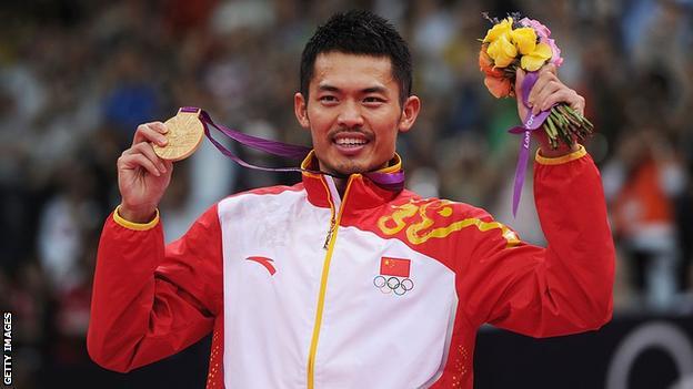 sport Lin Dan holds his London 2012 gold medal aloft