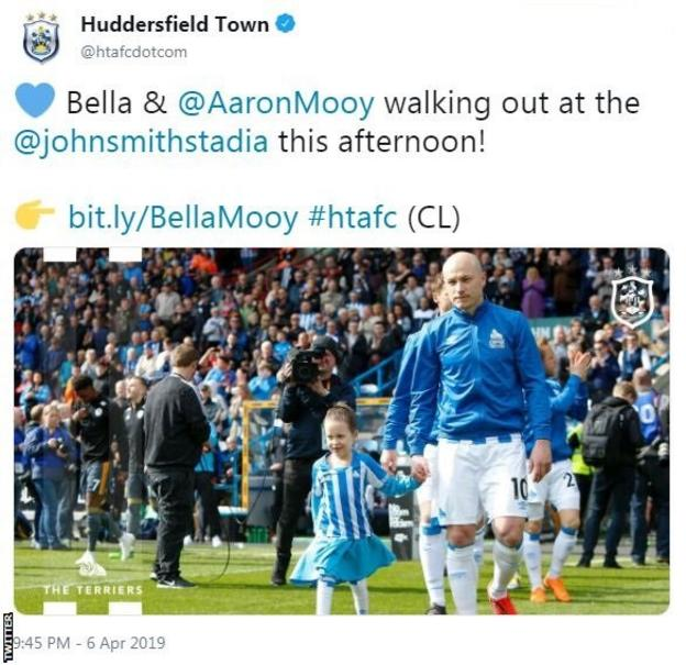 """Huddersfield Town tweet: """"Bella and Aaron Mooy walking out at the John Smith's Stadium this afternoon!"""""""