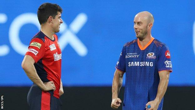 Chris Lynn (right) and Moises Henriques are two of Australia's players still in the IPL