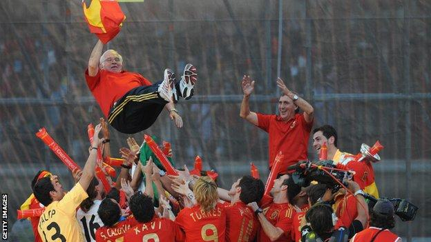Spanish players lift coach Luis Aragones up in the air after winning Euro 2008