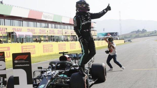 Lewis Hamilton celebrates pole position at Mugello