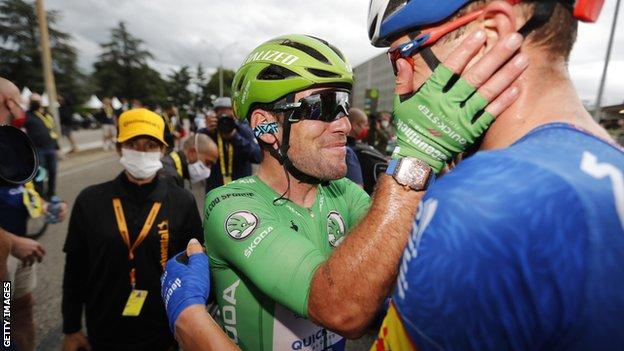 Mark Cavendish (left) celebrates with a Deceuninck-Quick-Step team-mate after winning stage 10 of the 2021 Tour de France