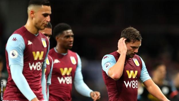 Aston Villa players react during their team's 6-1 home defeat to Manchester City