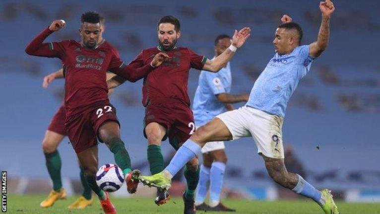 Man City 4-1 Wolves: Pep Guardiola says side 'came through hell' - BBC Sport