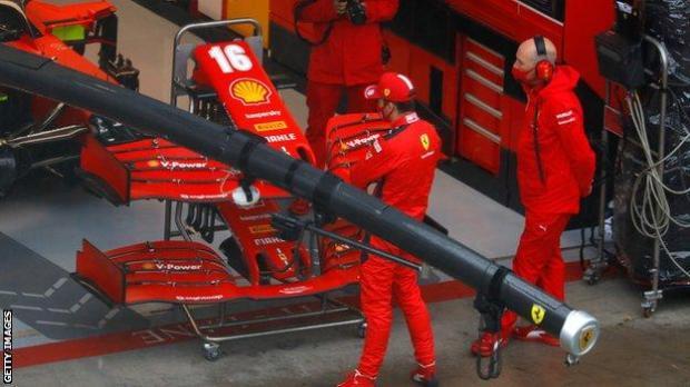 Charles Leclerc outside the Ferrari garage