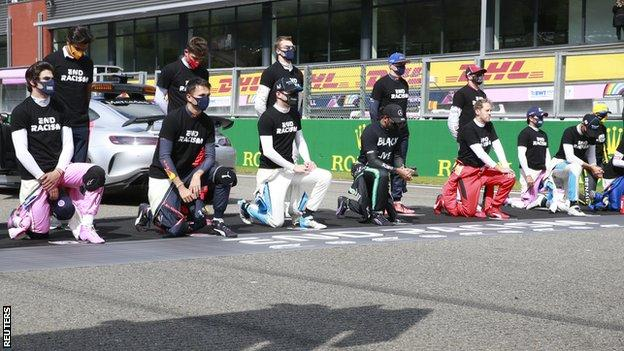Drivers take the knee or stand during the anti-racism protest