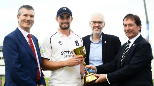 Ian Watmore, Warwickshire captain Will Rhodes,Warwickshire CEO Stuart Cain and Warwickshire chairman Mark McCafferty with the County Championship trophy