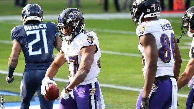 JK Dobbins celebrates a touchdown