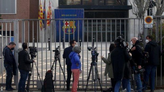 Reporters gathered outside Barcelona's club offices during a raid by regional police