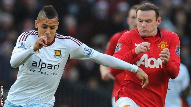 Ravel Morrison of West Ham United competes with Wayne Rooney of Manchester United in 2013