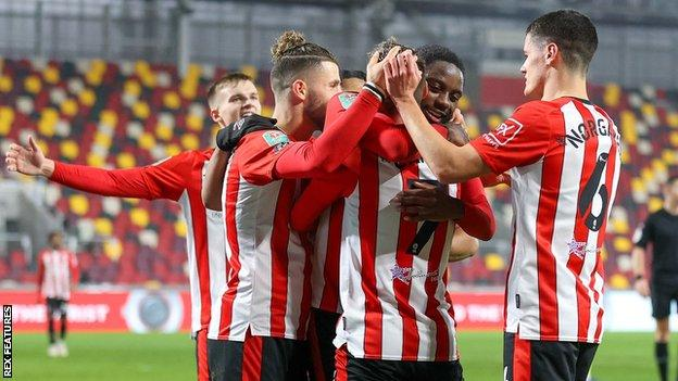 Brentford's players celebrate after scoring against Newcastle United in the quarter-finals of the Carabao Cup