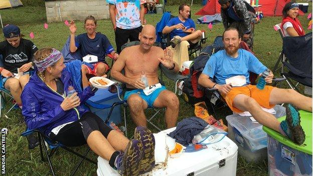 Big's competitors rest and eat in between laps