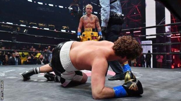 Jake Paul looks down on Ben Askren following his knockout