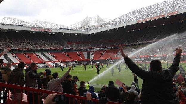 Fans on the Old Trafford pitch