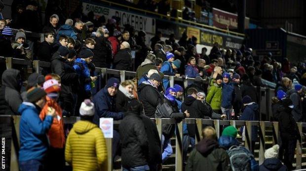Fans at Carlisle's Brunton Park