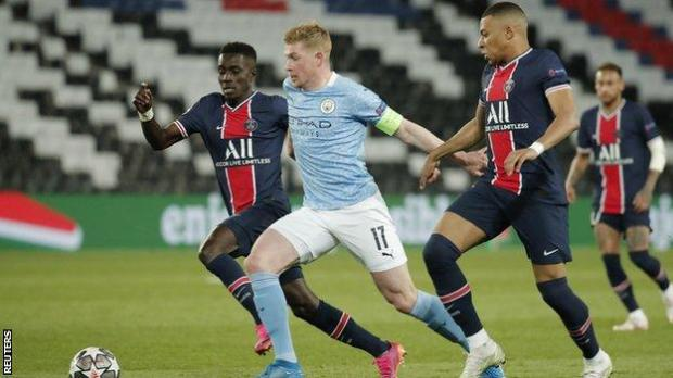 Kevin de Bruyne, Idrissa Gueye and Kylian Mbappe compete for the ball during the Champions League semi-final