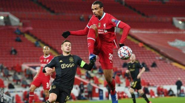 Liverpool's Joel Matip in action with Ajax's Dusan Tadic during the Champions League Group D game at Anfield