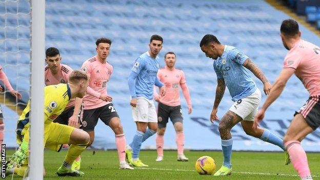 """Pep Guardiola said his Manchester City players were """"fighting like animals"""" after the Premier League leaders beat bottom club Sheffield United to record a club-record 12th successive victory."""