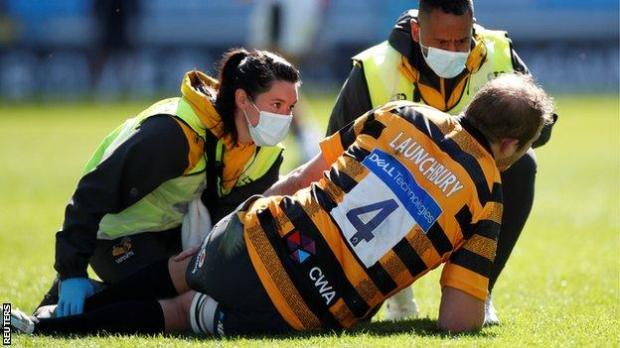 Joe Launchbury receives treatment for knee injury