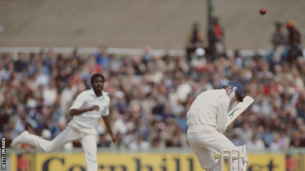 Michael Holding bowls a bouncer