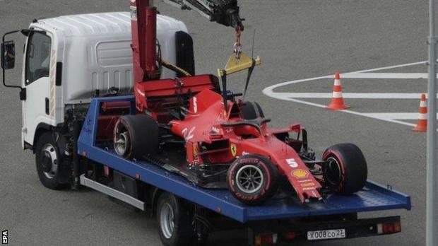Sebastian Vettel's Ferrari is towed away